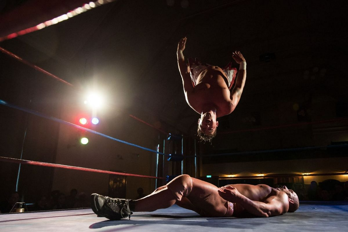 Professional wrestlers Robbie Dynamite and Dean 'Deano' Allmark (top) take part in a bout during an evening of wrestling entertainment presented by promoter 'All Star Superslam Wrestling' in Rhyl, north Wales on August 15, 2017. Founded in 1970, All