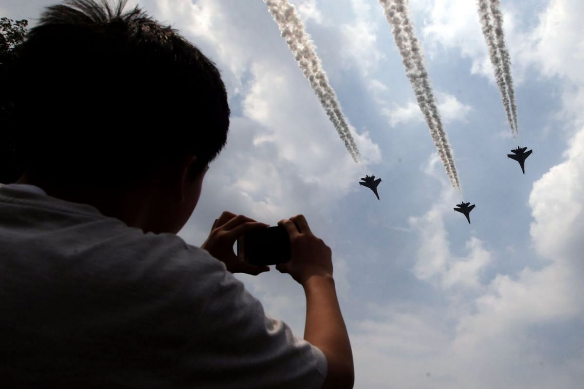 Indonesian Air Force jets flying past the state palace in Jakarta as part of the Independence Day celebrations.