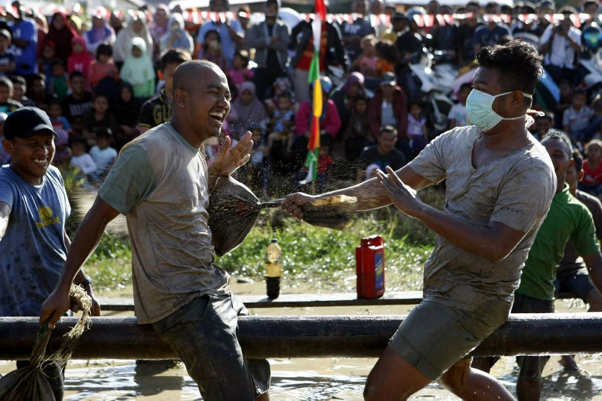 A pillow-fighting contest at Banda Aceh during Independence Day festivities.