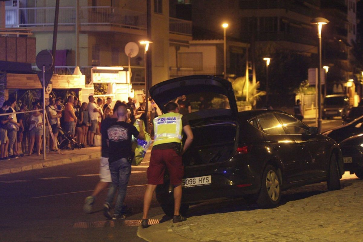 Spanish Policemen inspect a car after four suspected terrorists were killed by the police after they knocked down six civilians with their car at Paseo Maritimo in Cambrils (Tarragona), northeastern Spain, Aug 18, 2017.