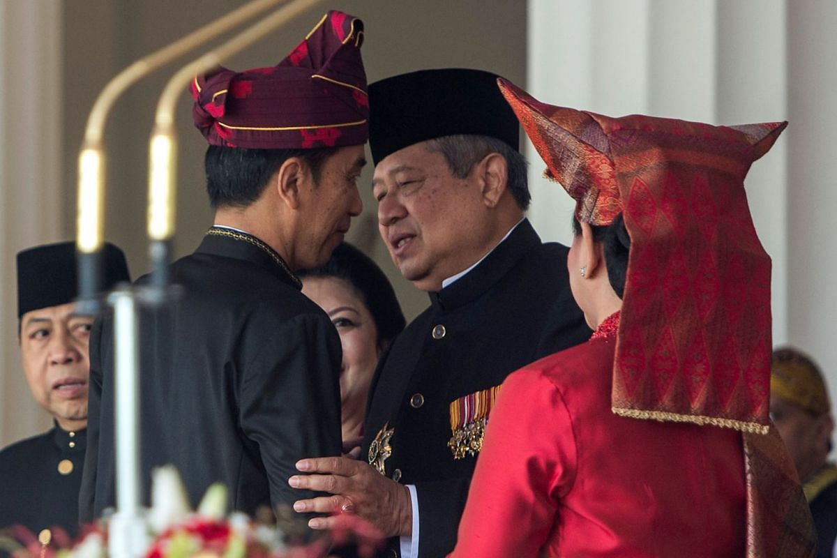 Indonesian President Joko Widodo (left) greeting former president Susilo Bambang Yudhoyono before a ceremony to mark Independence Day at the presidential palace in Jakarta.
