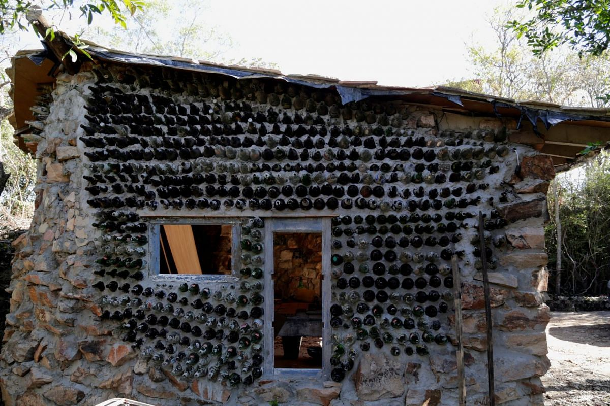 The wall of a house built with bottles and other recycled materials is seen in the countryside of Atyra, in Asuncion, Paraguay, Aug 16, 2017.