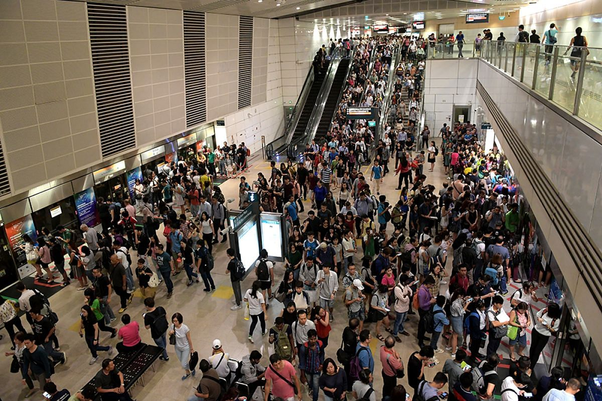 Crowding at the train platform in Bishan MRT station as commuters were hit by another round of train delays on the North-South Line and Downtown Line during Friday morning's rush hour.