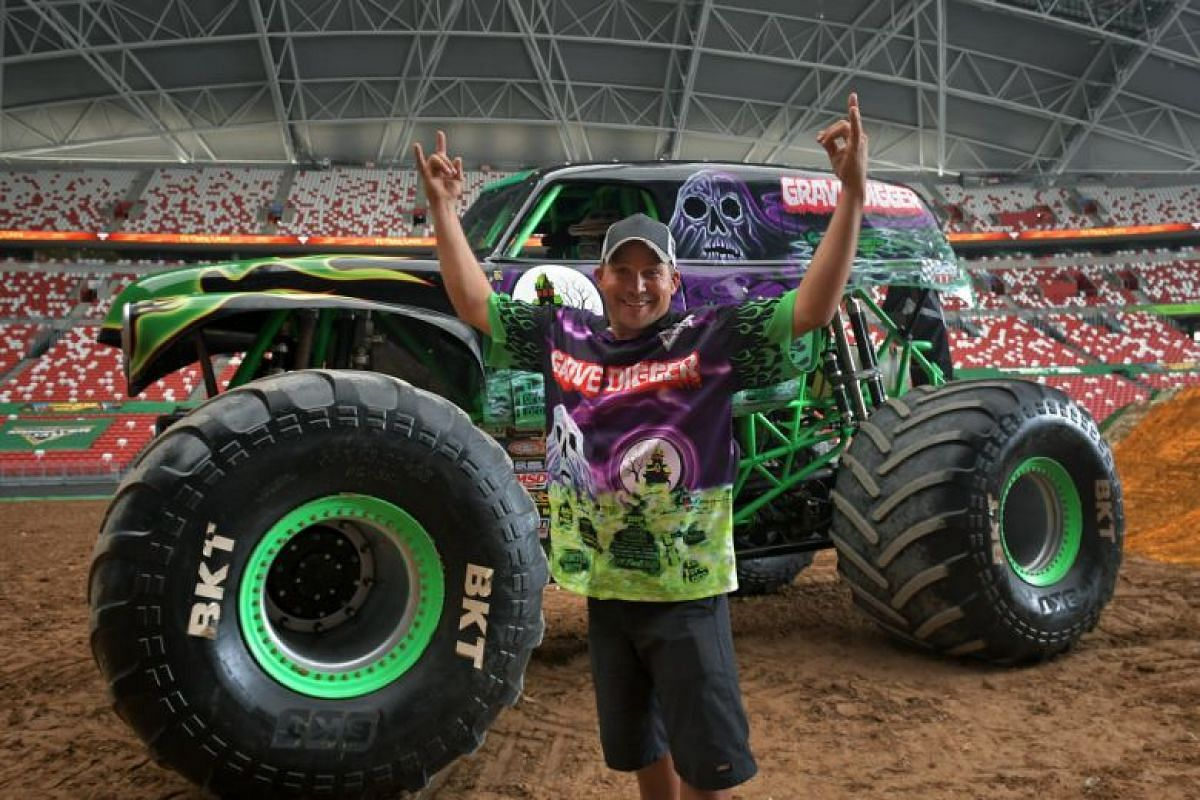 Jon Zimmer, who has 12 years of competitive Monster Jam truck-driving experience, stands in front of the truck he will be driving at Monster Jam, the Grave Digger.