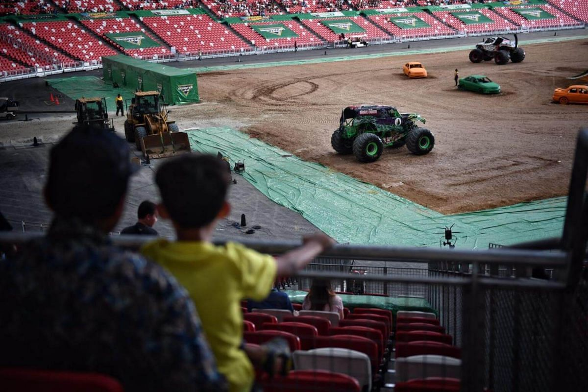 People with early access to see the monster trucks up close.