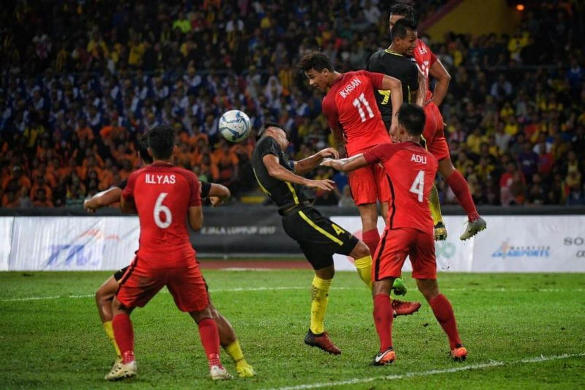 Singapore's Ikhsan Fandi heads the ball during the SEA Games football match between Singapore and Malaysia on Aug 16, 2017.