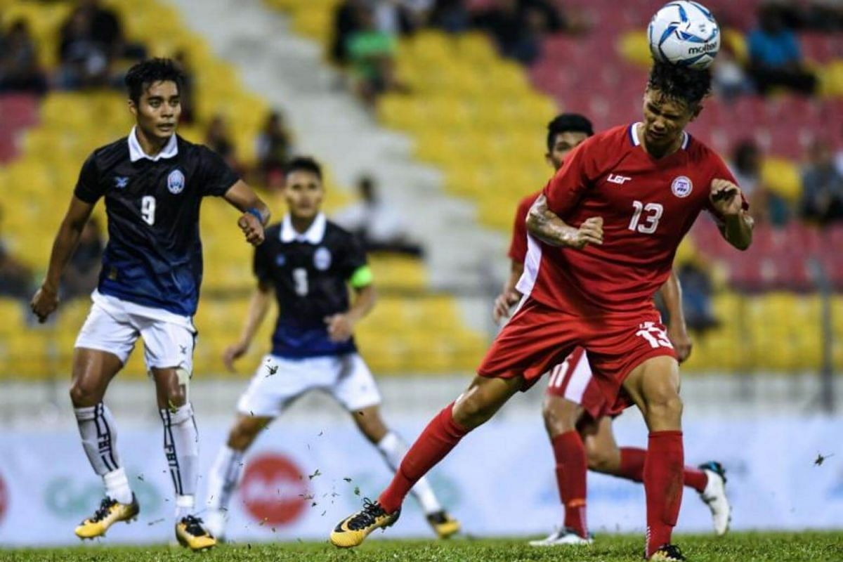 Philippines's player Joshua Jake Crommen (right) heads the ball during their men's football Group B round match against Cambodia at the 29th Southeast Asian Games (SEA Games) at Selayang Stadium, outside Kuala Lumpur on Aug 15, 2017.