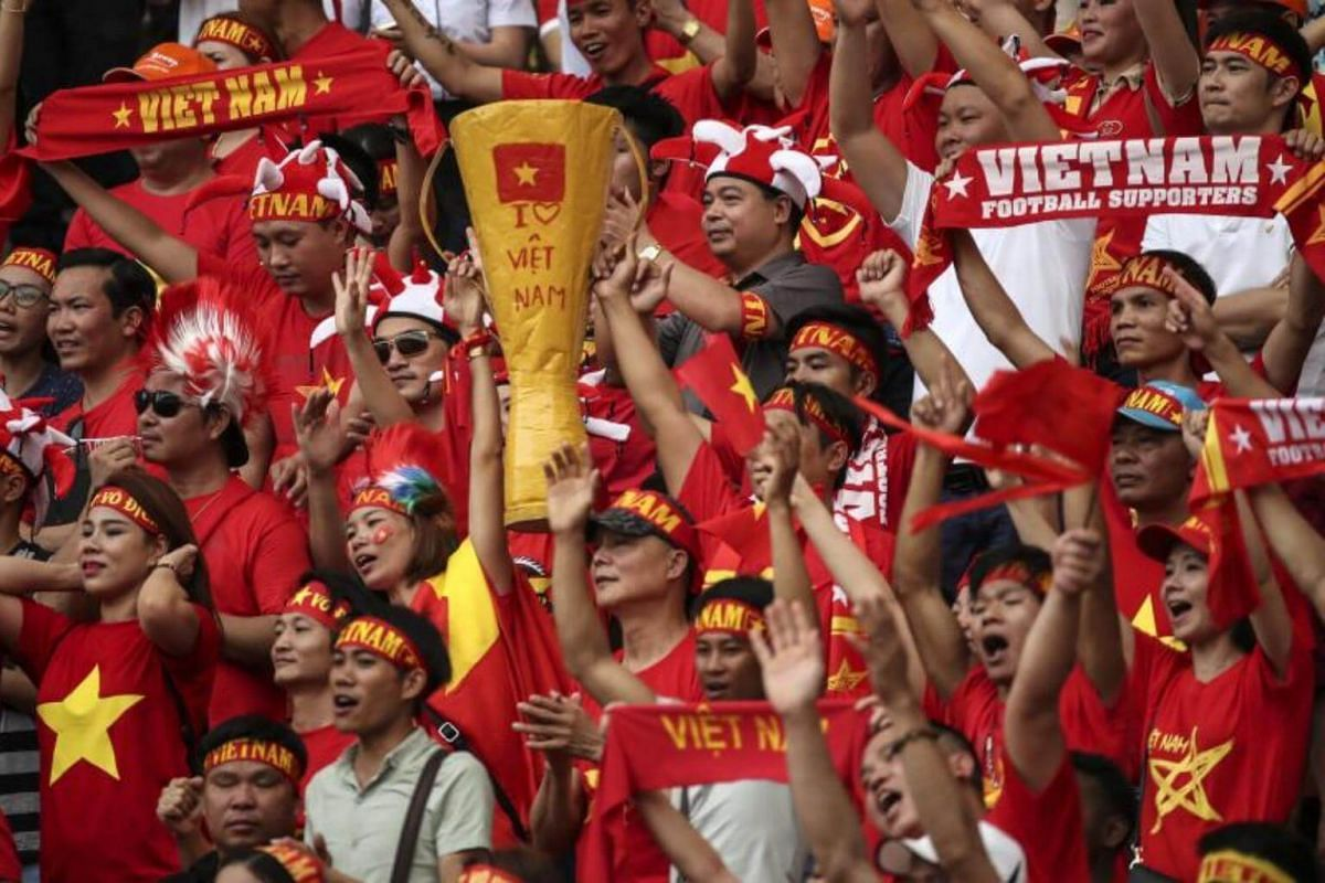 Vietnam's supporters celebrate their team goal during the Group B match Vietnam vs Cambodia of the SEA Games 2017 soccer events in Kuala Lumpur, Malaysia on Aug 17, 2017.