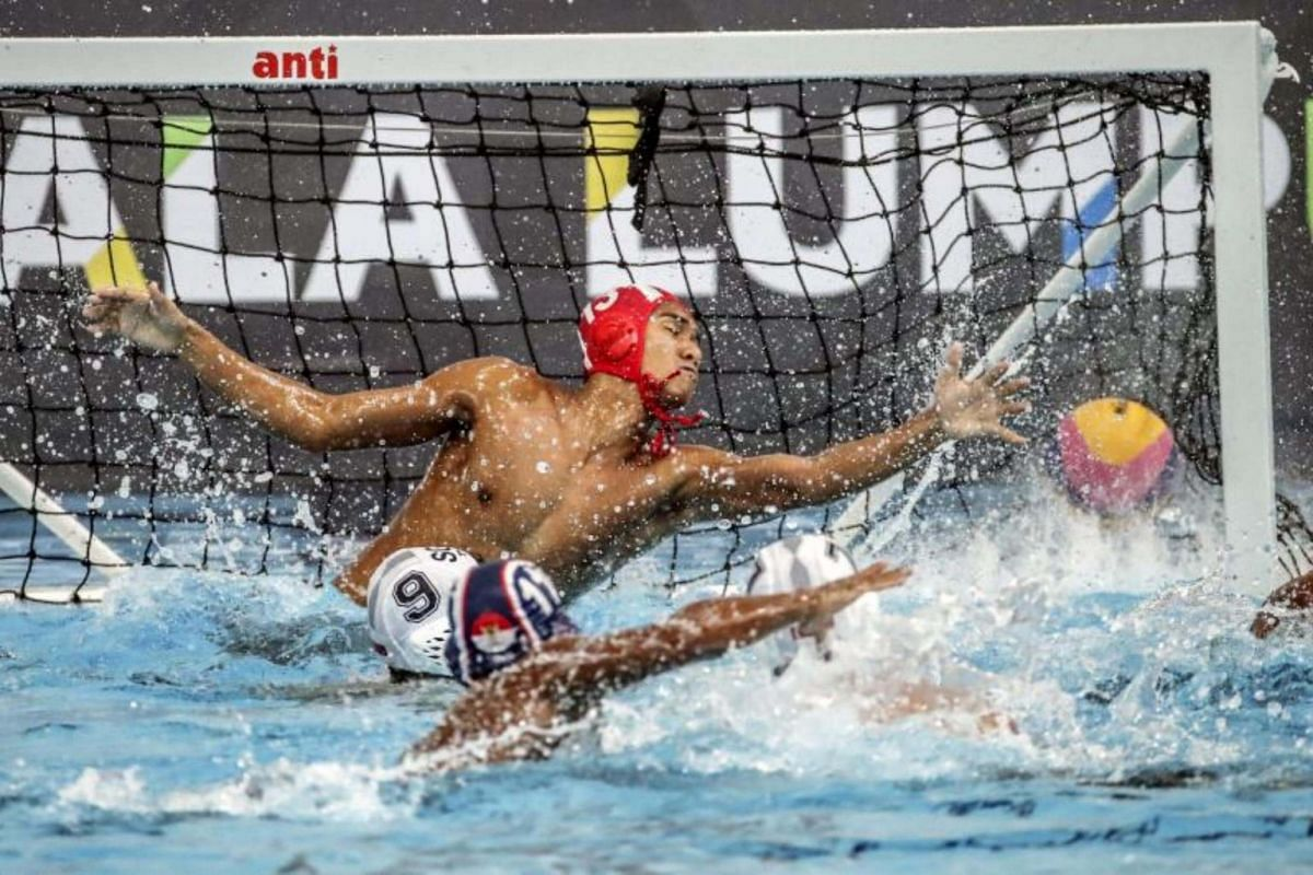 Novian Dwiputra (right) of Indonesia tries to save the ball against during Singapore the SEA Games 2017 Water Polo events in Kuala Lumpur, Malaysia on Aug 18, 2017.