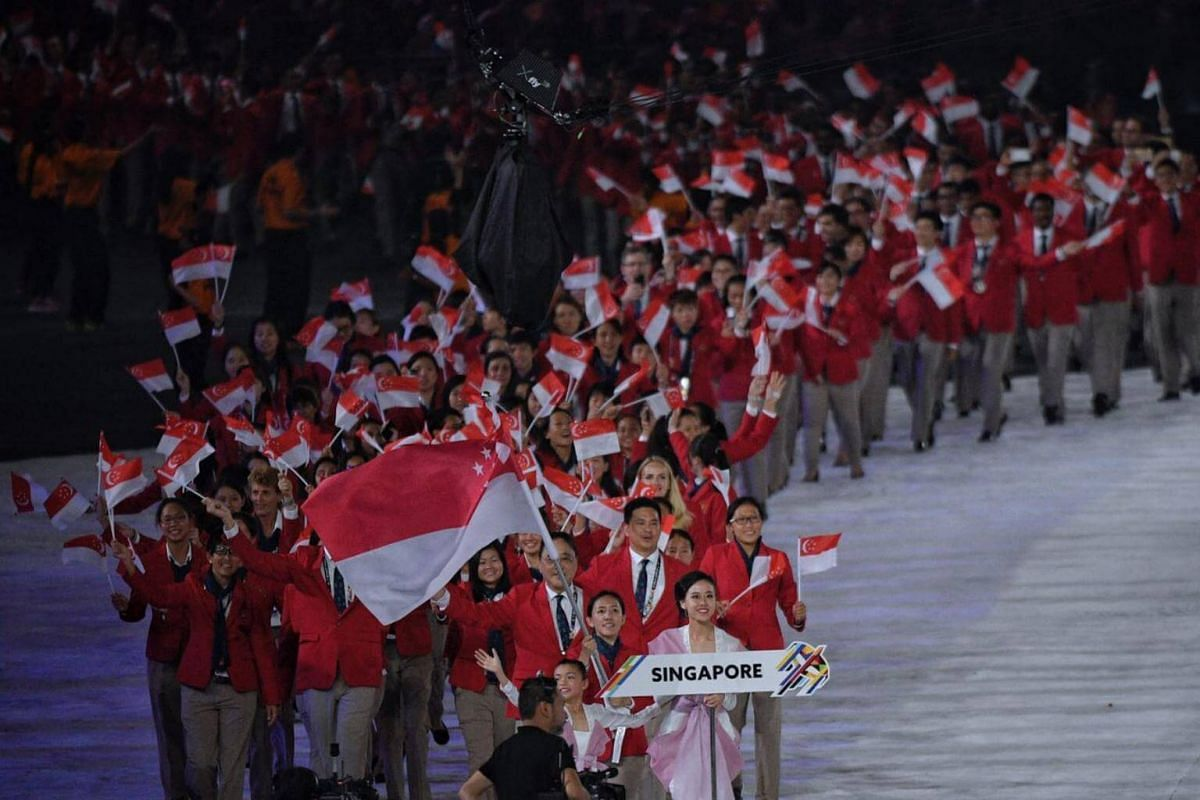 The Singapore contingent, lead by shooter Jasmine Ser, walk out during the athlete's parade.