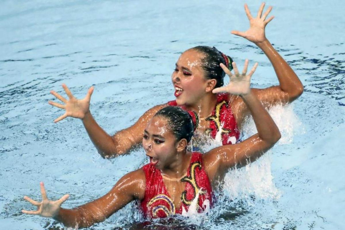 Anisa Feritrianti and Claudia Megwati Suyanto of Indonesia perform during the SEA Games 2017 syncronized swimming duet technical routine events in Kuala Lumpur, Malaysia on Aug 18, 2017.
