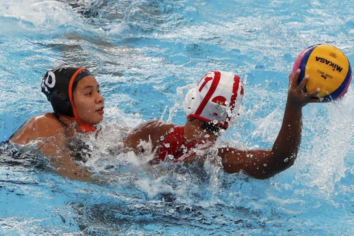 Trisha Then Chiah Huey (left) of Malaysia and Rani Raida (right) of Indonesia in action during the SEA Games 2017 Water Polo event in Kuala Lumpur on Aug 19, 2017.