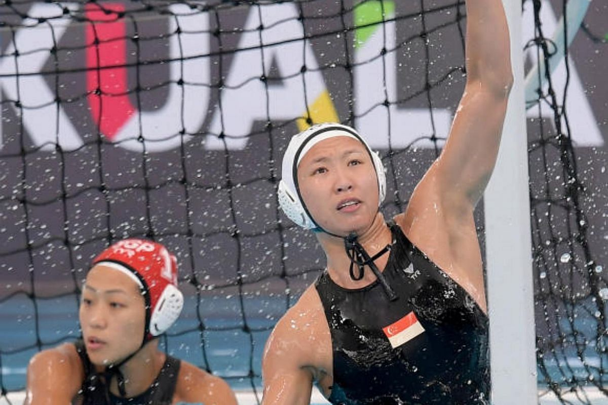 Singapore's Angeline Tan rises to block a shot by Thailand during the 29th SEA Games women's water polo competition at the National Aquatic Centre at Bukit Jalil, Kuala Lumpur on Aug 19, 2017.
