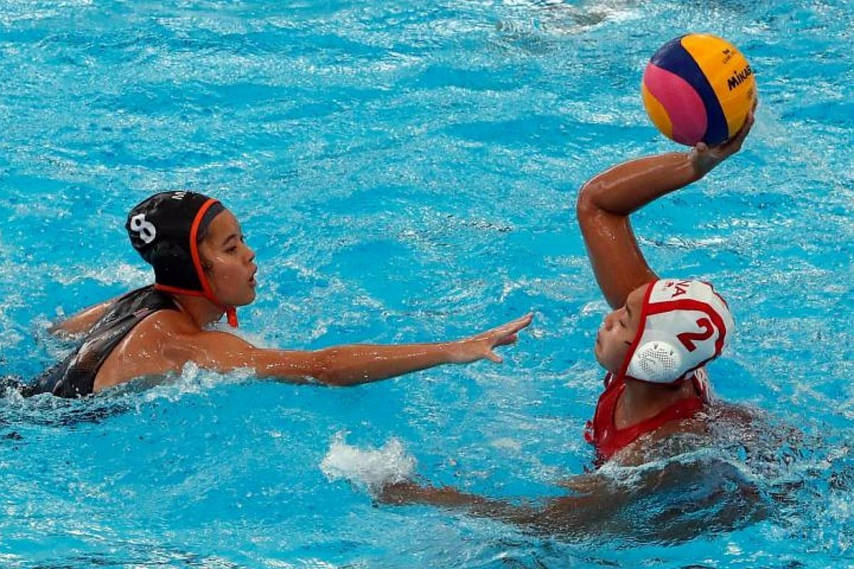 Low Jia Yee (left) of Malaysia and Annija Rachmawati (right) of Indonesia in action during the SEA Games 2017 Water Polo event in Kuala Lumpur, Malaysia, on Aug 19, 2017.