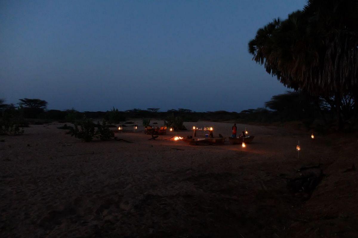 Dine under the stars at the Saruni Rhino lodge.
