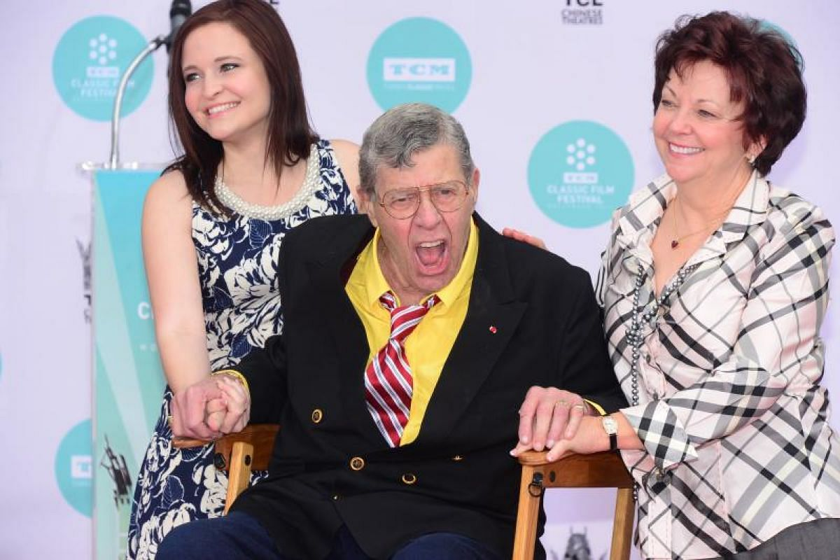 Jerry Lewis with his wife SanDee Pitnick and daughter Danielle at his Hand and Footprint ceremony at the TCL Theater in Hollywood, California, on April 12, 2014.