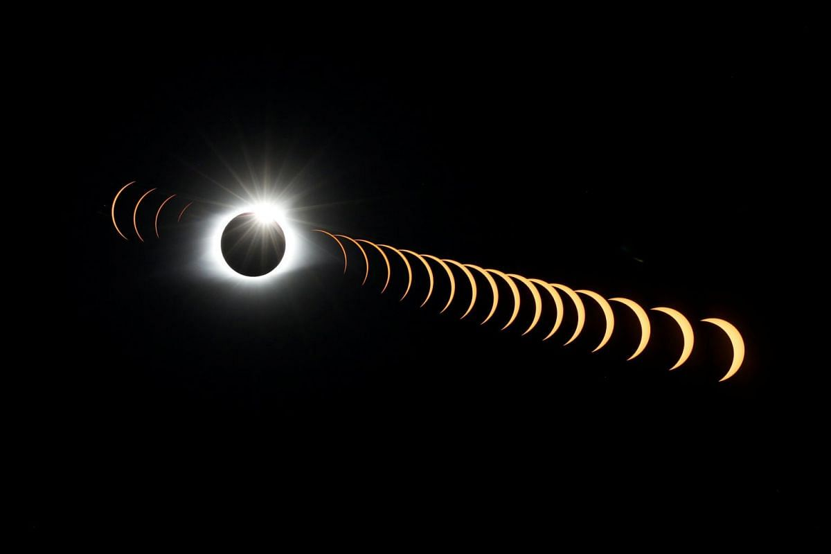 A multiple exposure image shows the solar eclipse as it creates the effect of a diamond ring at totality as seen from Clingmans Dome, which at 6,643 feet (2,025m) is the highest point in the Great Smoky Mountains National Park, Tennessee, U.S. August
