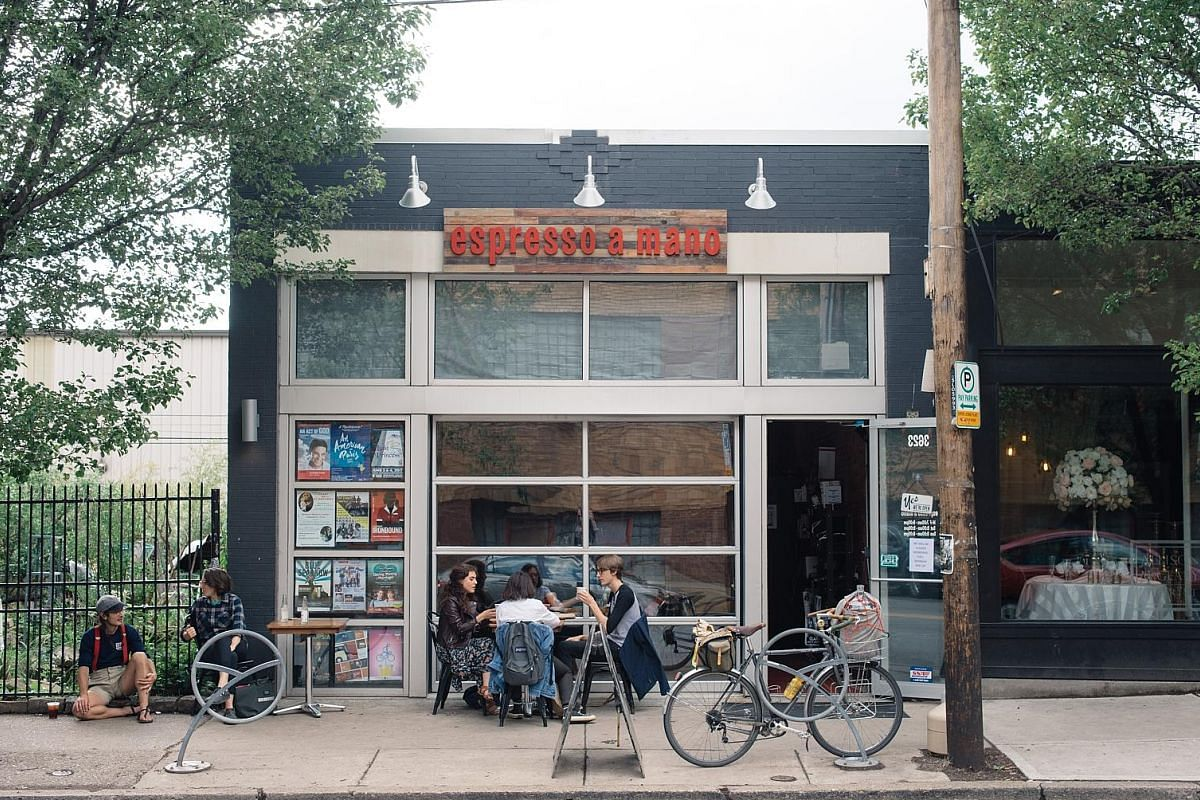 Young people hanging out at Espresso a Mano, one of many cafes in Pittsburgh's trendy Lawrenceville neighbourhood. Once a place young people fled from, Pittsburgh has been transformed into a hot spot for millennials, thanks to a bounty of tech-sector jobs