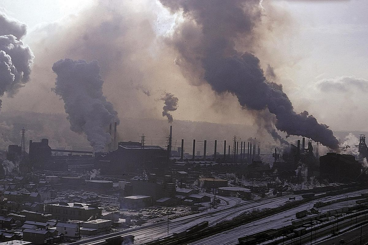 Smokestacks of a Pittsburgh steel mill in a photo taken around 1970. This mill closed in the early 1980s. Stricter environmental requirements forced many mills to shut.