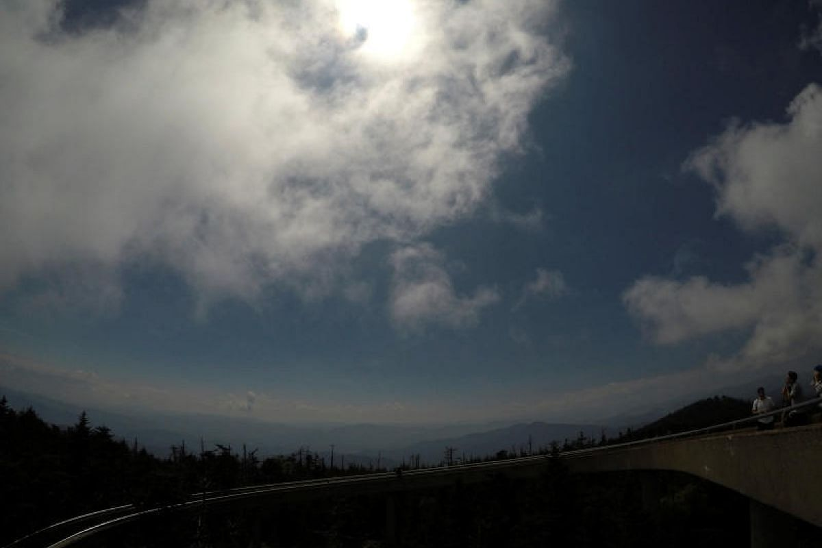 Clouds clearing away in the minutes before the solar eclipse reached totality, seen from the observation tower atop Clingmans Dome on Aug 21, 2017. At 2,025m, it is the highest point in the Great Smoky Mountains National Park, Tennessee, the United S