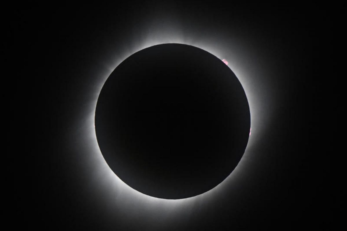 The sun in full eclipse over Grand Teton National Park on Aug 21, 2017, outside Jackson, Wyoming.
