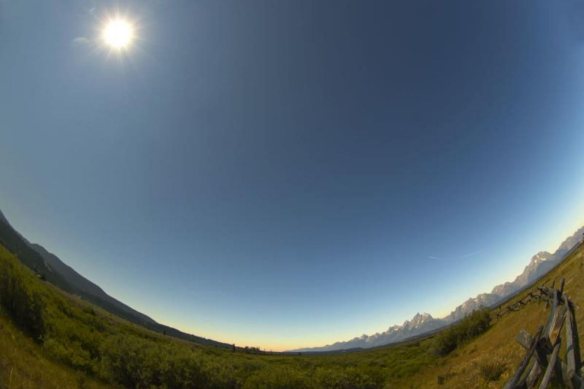 The sun has just come out of the full eclipse over Grand Teton National Park on Aug 21, 2017, outside Jackson, Wyoming. Thousands of people have flocked to the Jackson and Teton National Park areas for the total solar eclipse.