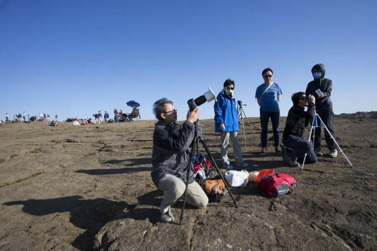 Mr Chan Kihung, who is from Hong Kong, preparing his eclipse viewing gear on Menan Butte on Aug 21, 2017, in Menan, Idaho.
