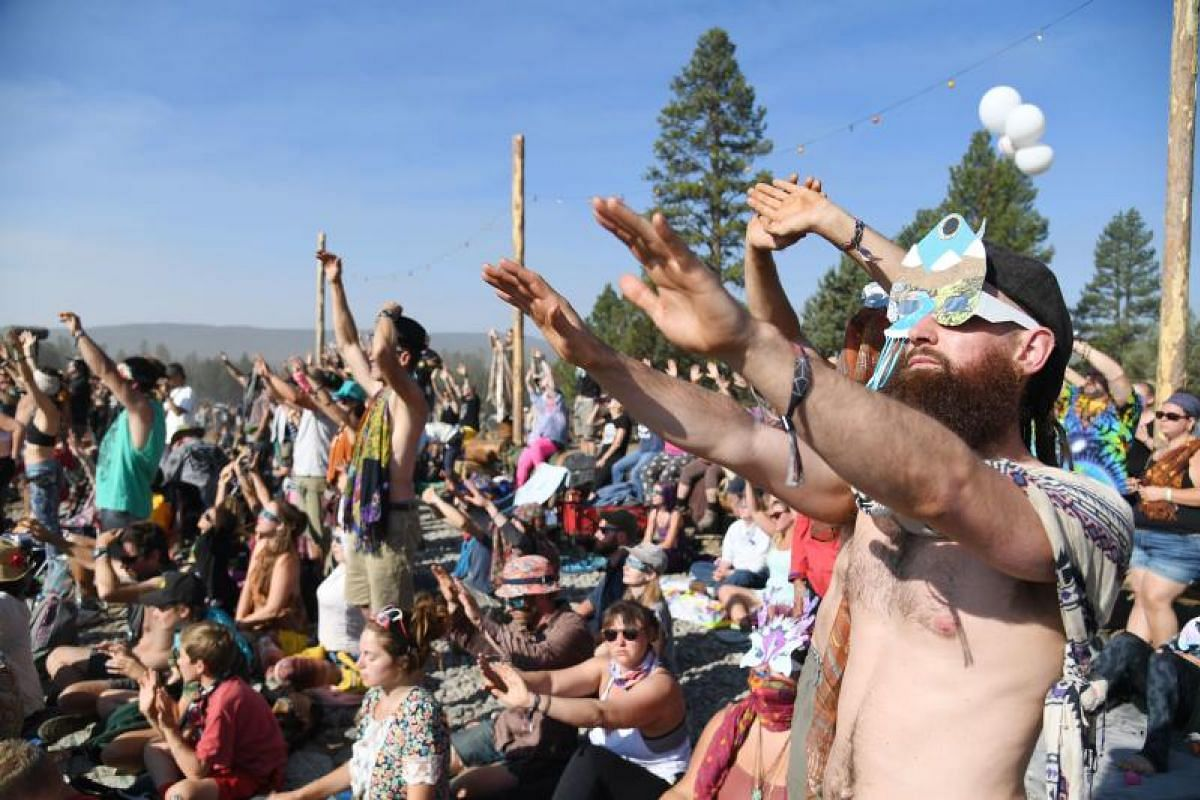 People watching the total solar eclipse at Big Summit Prairie ranch in Oregon's Ochoco National Forest, near the city of Mitchell, on Aug 21, 2017.