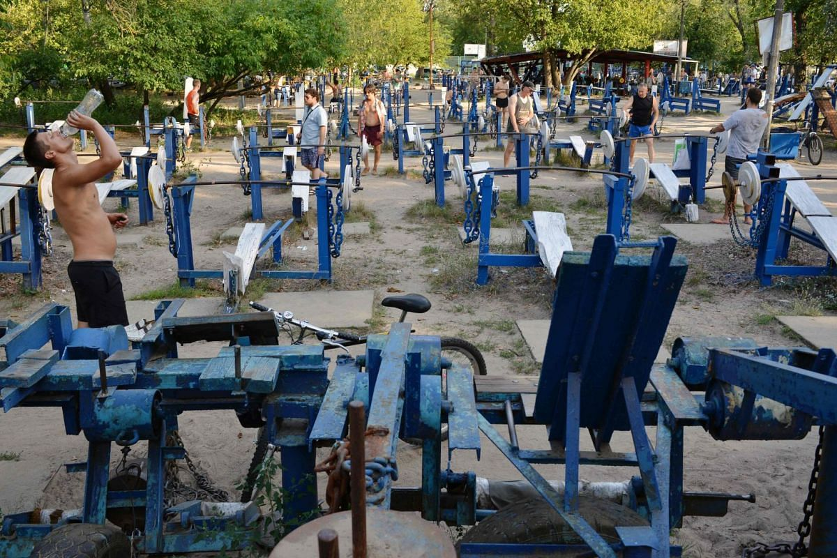 People exercise at an open air gym in Ukraine's capital Kiev. Founded in the 1970s, the busy open air gym, called Kachalka in Ukrainian (or Pumping) is located in the city center and offers hundreds of different self-made gym machines, made out of sc
