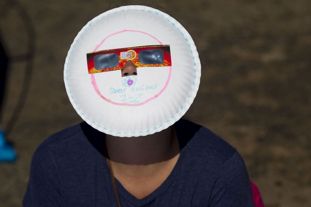 "Locals and travelers from around the world gather on Menan Butte to watch the eclipse on August 21, 2017 in Menan, Idaho. Millions of people have flocked to areas of the U.S. that are in the ""path of totality"" in order to experience a total solar ecl"
