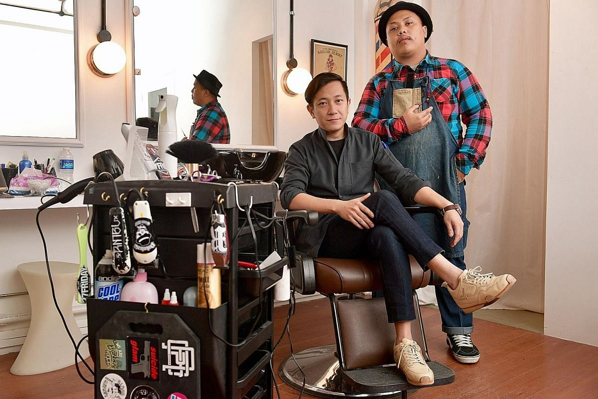 Co-owner of barber shop Might Of Many Edwin Neo (above left) and head barber Mohammad Syafa'at.