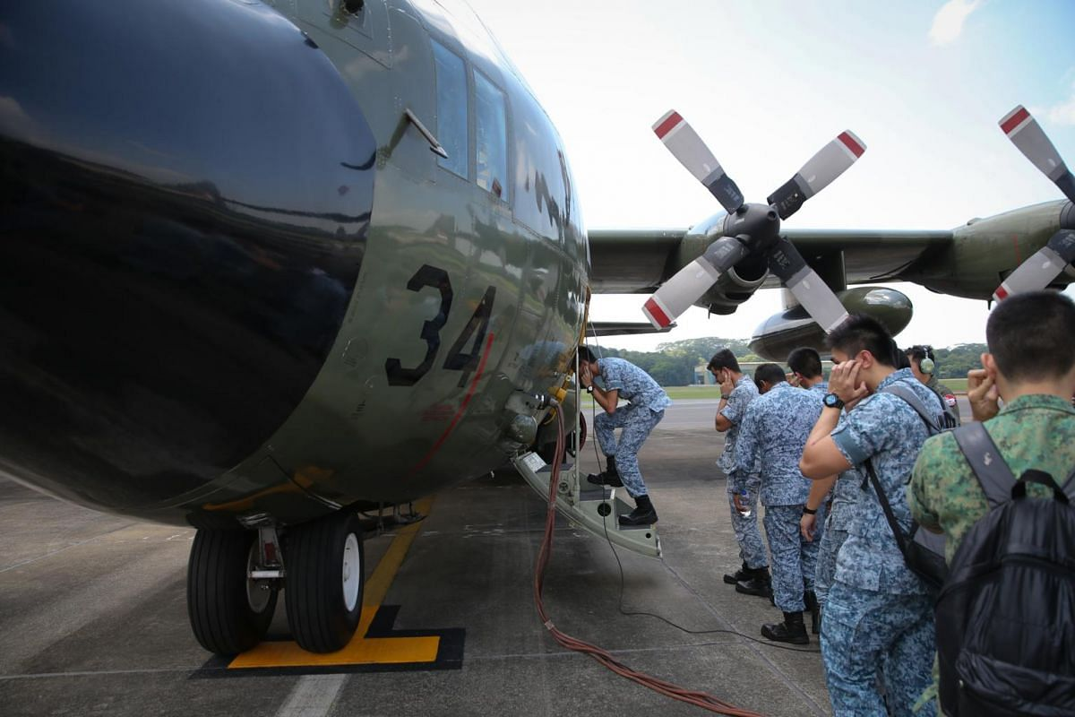RSAF personnel boarding a C-130 before a search for missing sailors from the USS John S. McCain on Day Three of the multi-national search-and-rescue efforts on Aug 23, 2017.