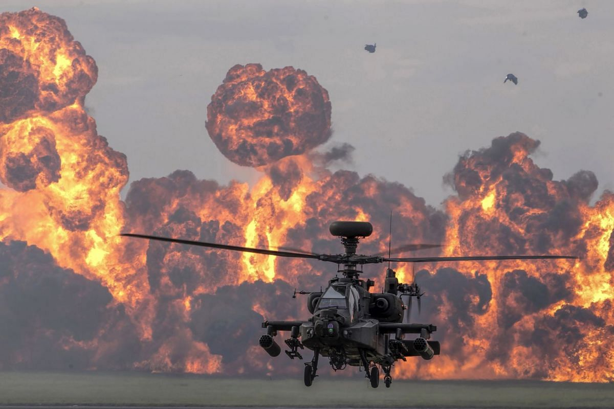 A handout photo made available by the British Ministry of Defence showing a British Army Air Corps Apache attack helicopter, from the Attack Helicopter Display Team, giving a display, celebrating the 60th anniversary of the Army Air Corps and 75th an