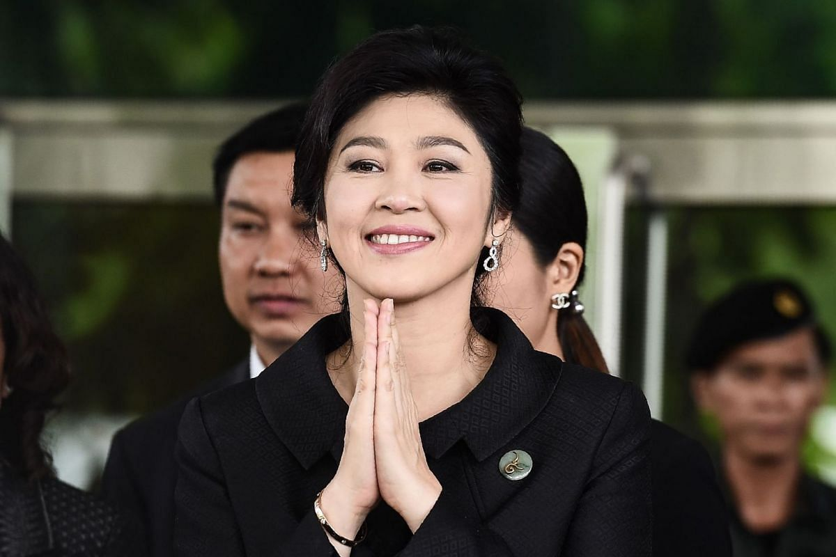 A file photo of former Thai prime minister Yingluck Shinawatra greeting her supporters as she leaves the Supreme Court in Bangkok. Thai ex-prime minister Yingluck Shinawatra missed a verdict in a negligence trial on August 25, 2017 that could have se