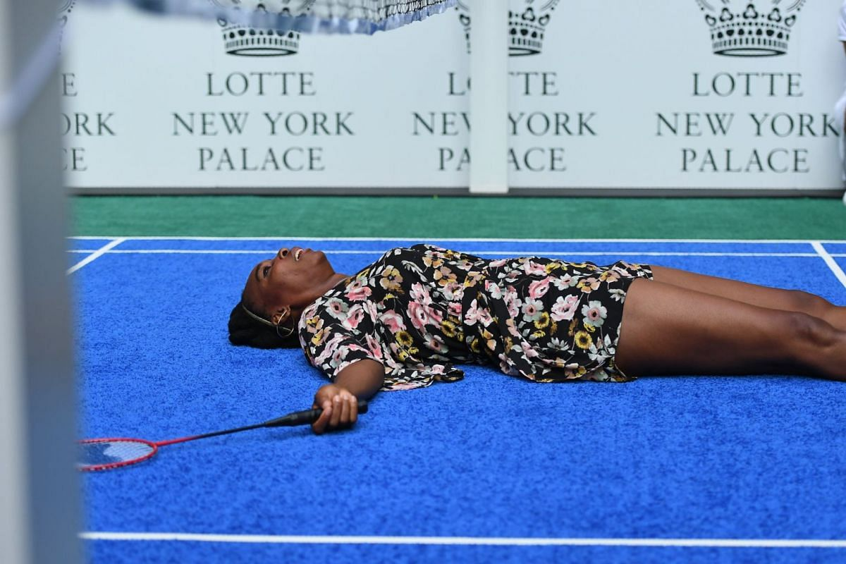 Venus Williams of the USA falls down during her match to world number one tennis player Rafael Nadal of Spain as they participate in the Lotte New York Palace Invitational Badminton Tournament at the Lotte New York Palace in New York August 24, 2017.