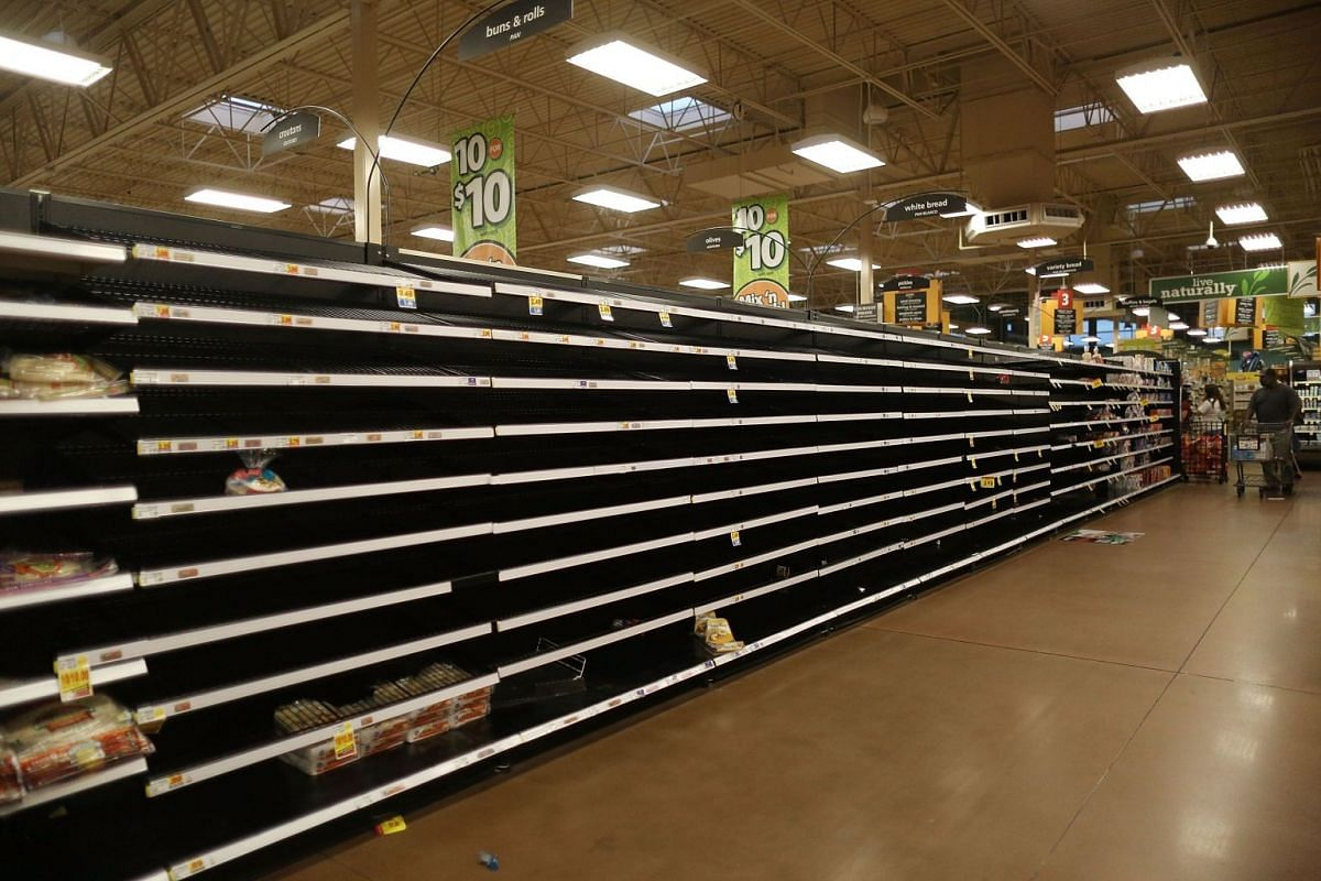 The bread section of a Kroger store is empty as people prepare for the possible arrival of Hurricane Harvey on August 24, 2017 in Houston, Texas.