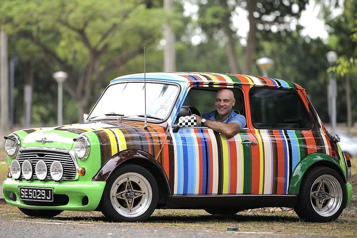 Mr Chris Mead (above) with his colourful 1971 Austin Mini Cooper. Mr Steven Junior Teo's Minions-themed car (above). Mr Jeffrey Loy (left) got a Frozen wrap job on his car because his daughter Crystal is mad about the film. Mr Cash Chong (above, with