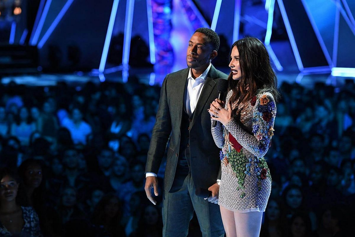 Ludacris and Olivia Munn speak onstage during the 2017 MTV Video Music Awards on Aug 27, 2017.