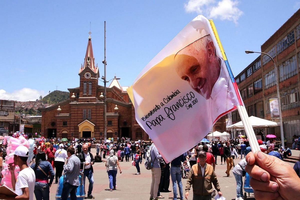 A man sells flags with the image of Pope Francis at the Divino Nino Jesus church in Bogota, on Aug 27, 2017.