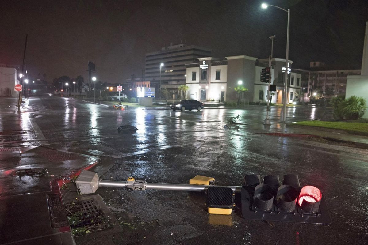 A traffic signal felled by the high winds of Hurricane Harvey lies on a street in Corpus Christi, Texas, on Aug 26, 2017.