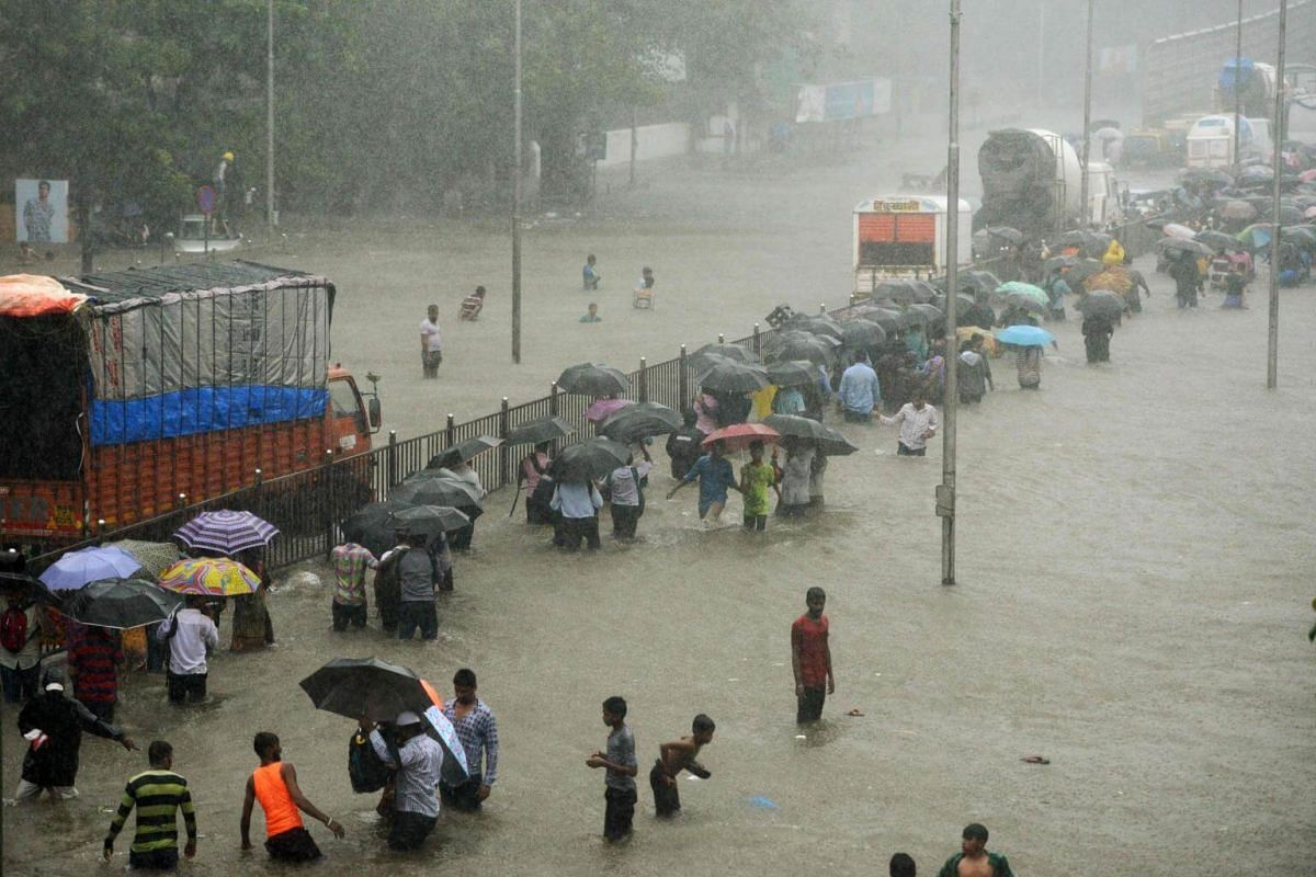 Heavy rain brought India's financial capital Mumbai to a virtual standstill on Aug 29, flooding streets, causing transport chaos and prompting warnings to stay indoors.
