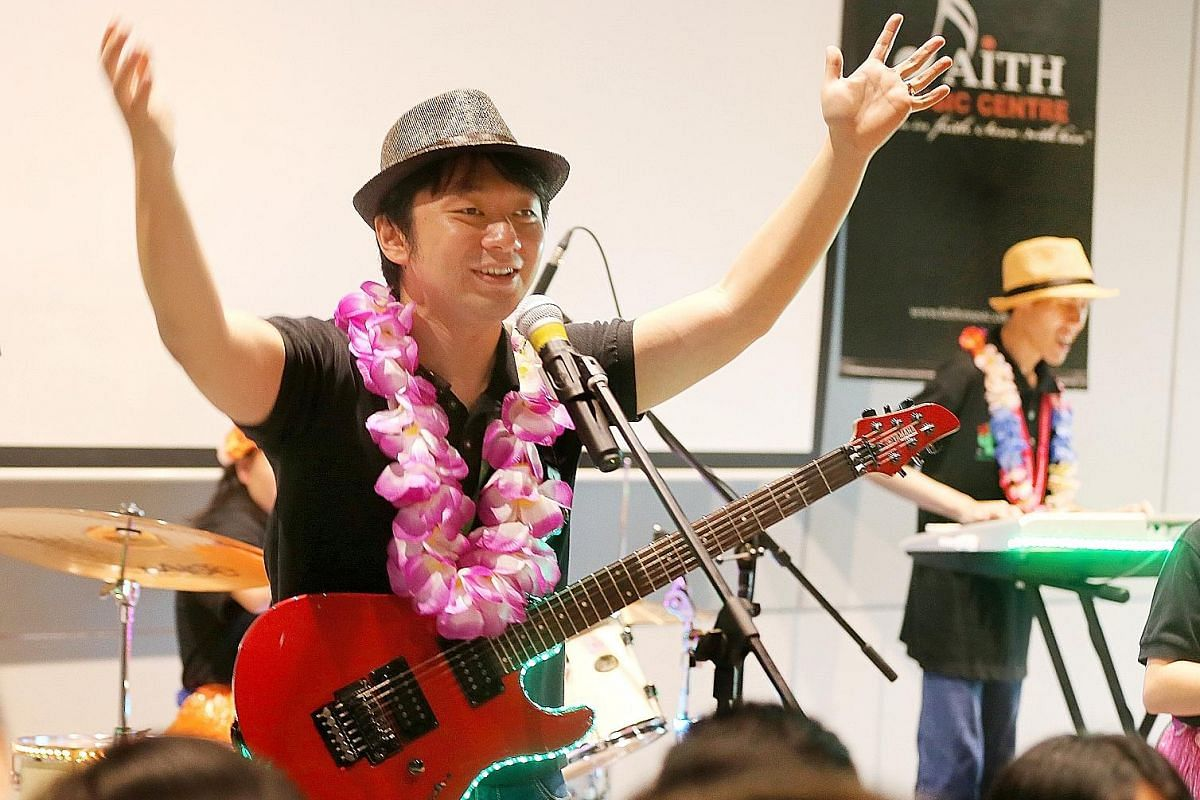 Guitarist and lead vocalist Ken Wong, 29, who has macular dystrophy, is part of Cactus Rose, a band whose musicians have disabilities. They held a concert at the Enabling Village in Lengkok Bahru last Friday.