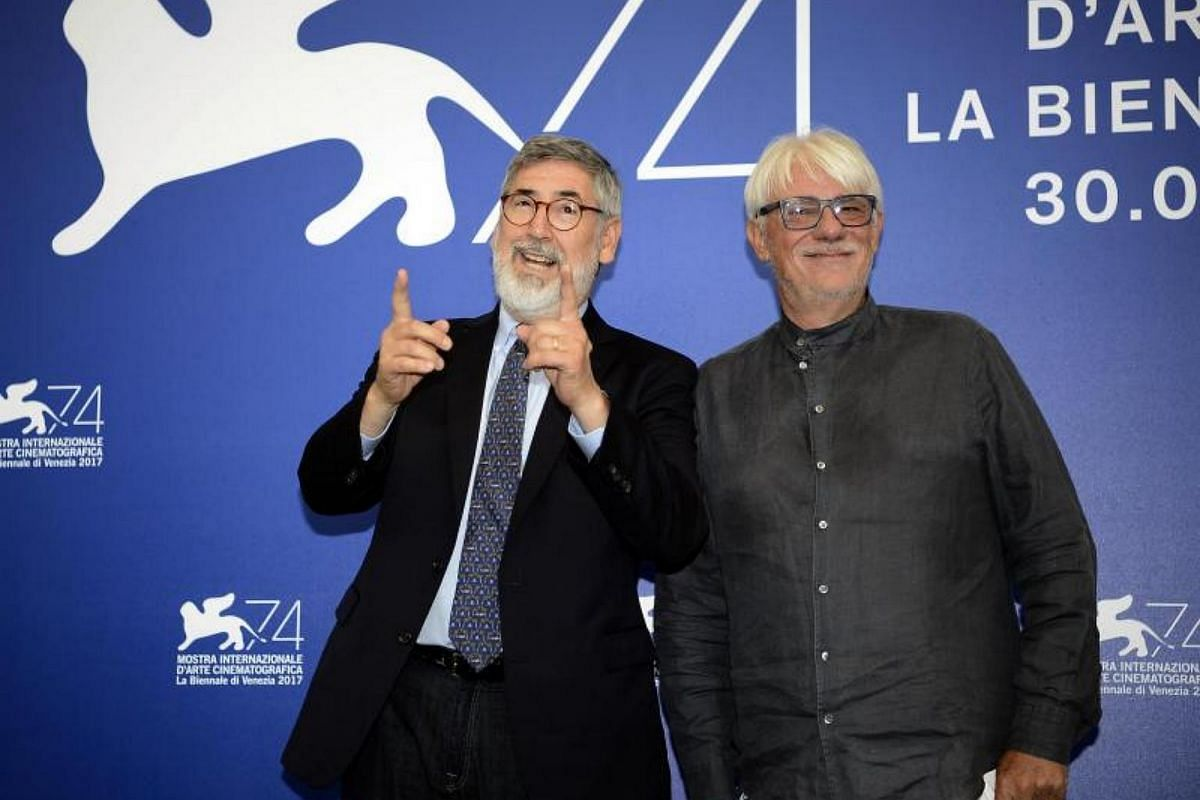 Members of the Venice VR jury , US director John Landis (left) and Italian director and actor Ricky Tognazzi (right) pose during a photocall of the jury Venice VR at the 74th annual Venice International Film Festival, in Venice, Italy, on Aug 30, 201