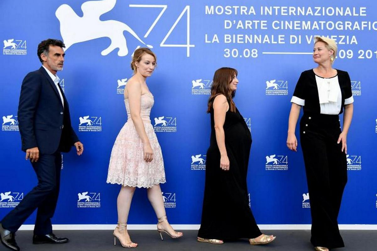 (left to right) Italian actor Thomas Trabacchi, Romanian actress Anamaria Marinca, British actress Karina Fernandez, and Danish actress Trine Dyrholm pose during a photocall for Nico, 1988, at the 74th annual Venice International Film Festival, in Ve
