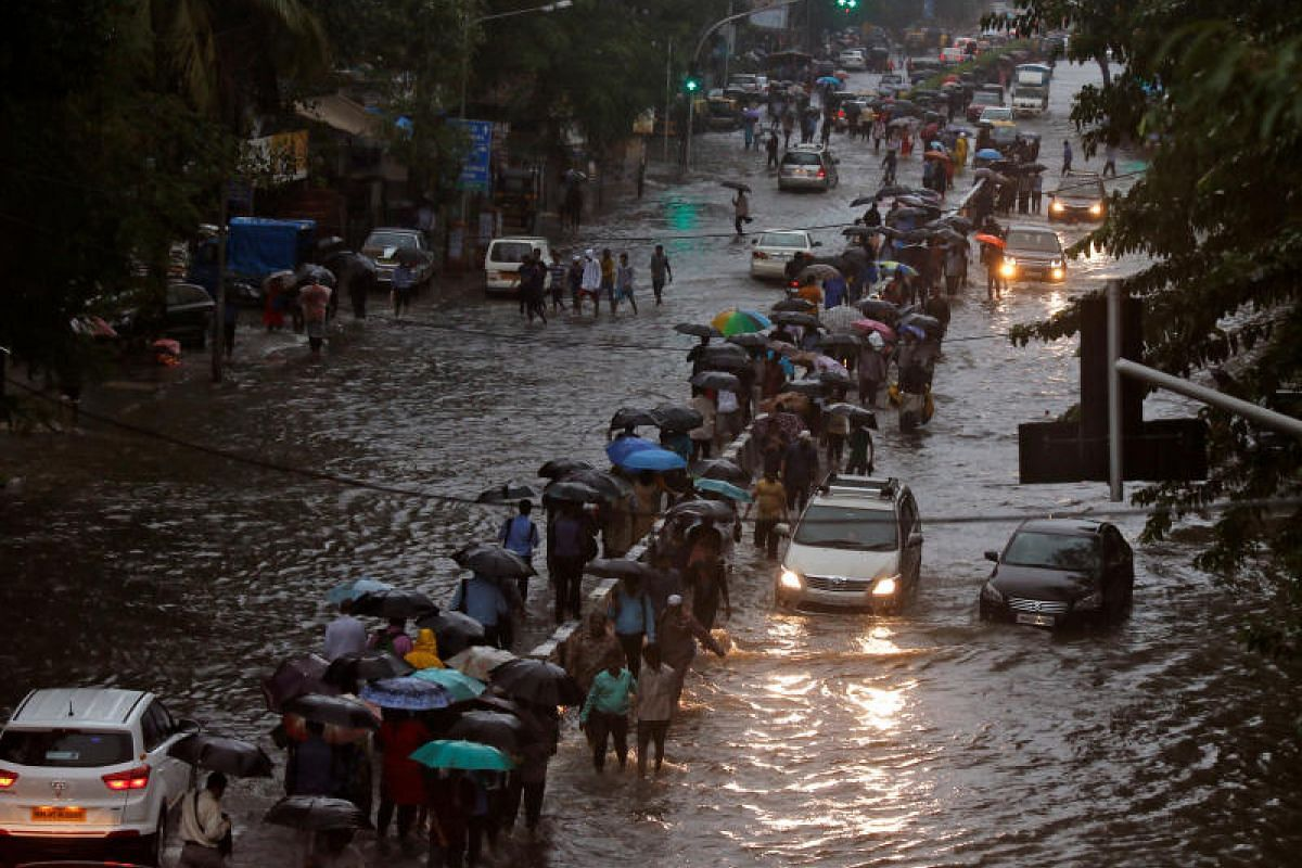 Commuters walking through waterlogged roads in Mumbai, India, on Aug 29. Floods have killed more than 1,000 people in India, Nepal and Bangladesh in recent weeks and forced millions from their homes in the region's worst monsoon disaster in recent