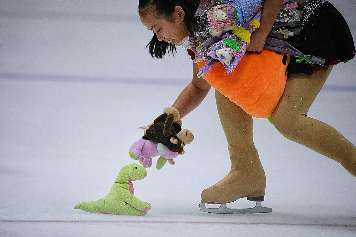 Clockwise from above: A girl picks up soft toys and flowers from fans of Malaysian figure skater Julian Yee after his gold medal-winning performance. The Games organisers' target audience must have included young supporters and this baby did not disa