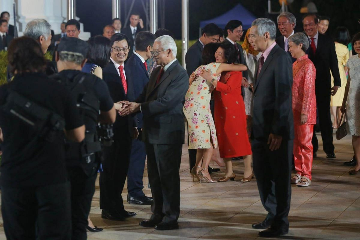 A long line of ministers and VIPs shake hands with President Tony Tan at his farewell reception and ceremony held at the Istana.