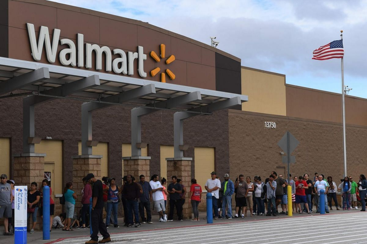 People wait in line for a Walmart store to open after Hurricane Harvey caused heavy flooding in Houston, on Aug 30, 2017.