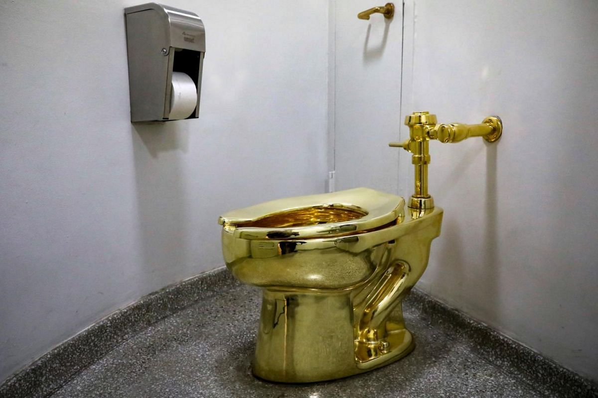 Maurizio Cattelan's America, a fully functional solid gold toilet at The Guggenheim Museum in New York City, on Aug 30, 2017.