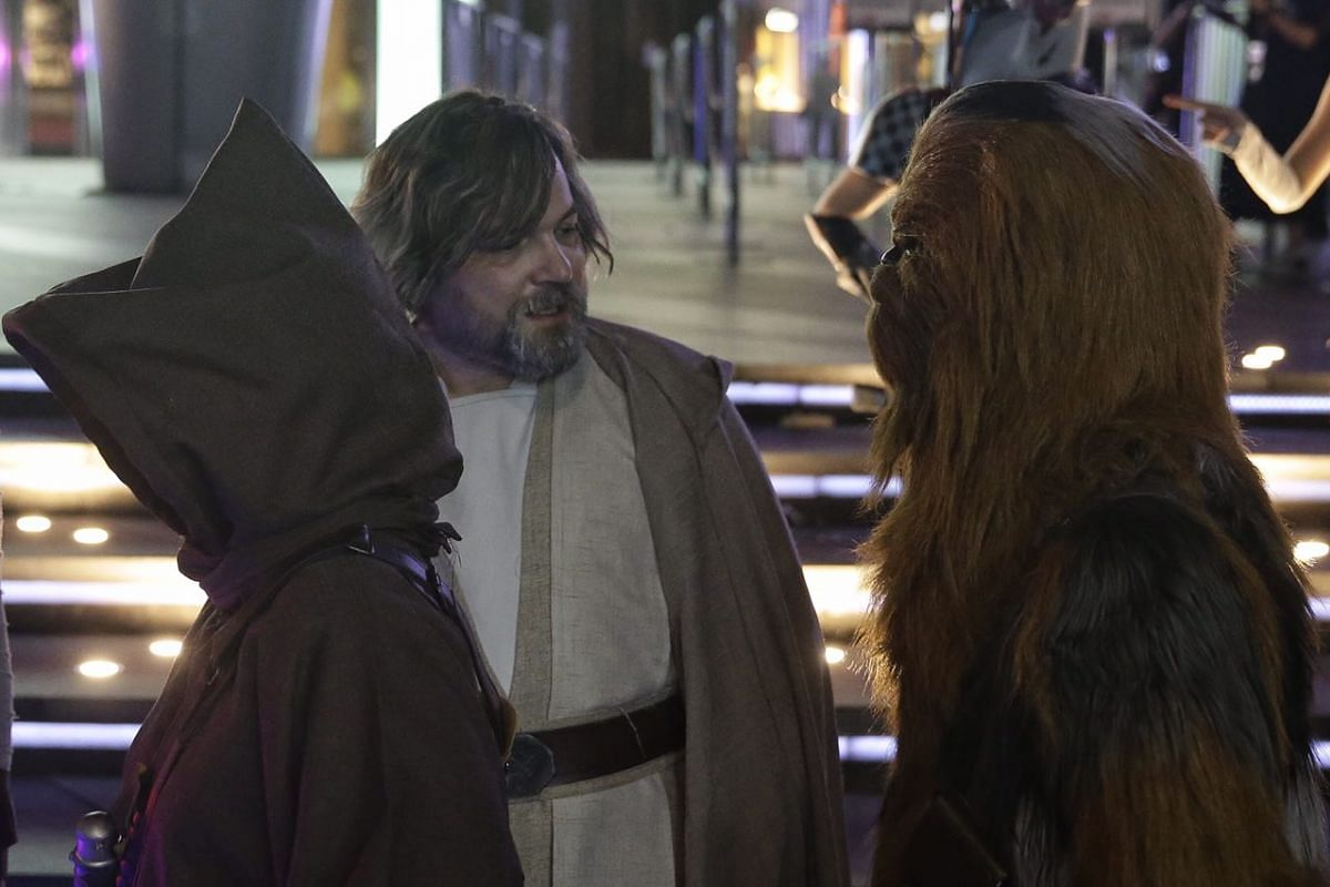 A Luke Skywalker cosplayer in discussion with a Chewbacca cosplayer outside ION Orchard on Aug 31, 2017.